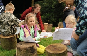 Children learning how to write the ancient script of trees